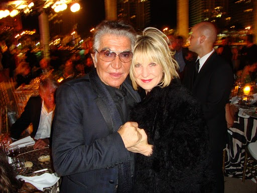 Elysze Held with designer Roberto Cavalli.